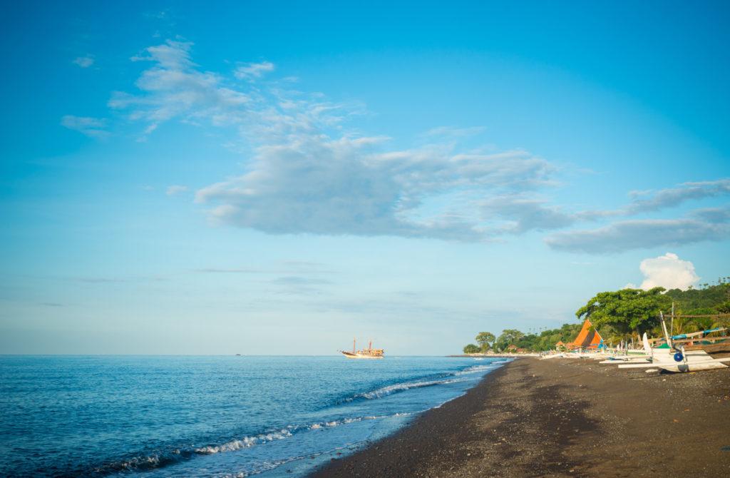 Amed black sand beach